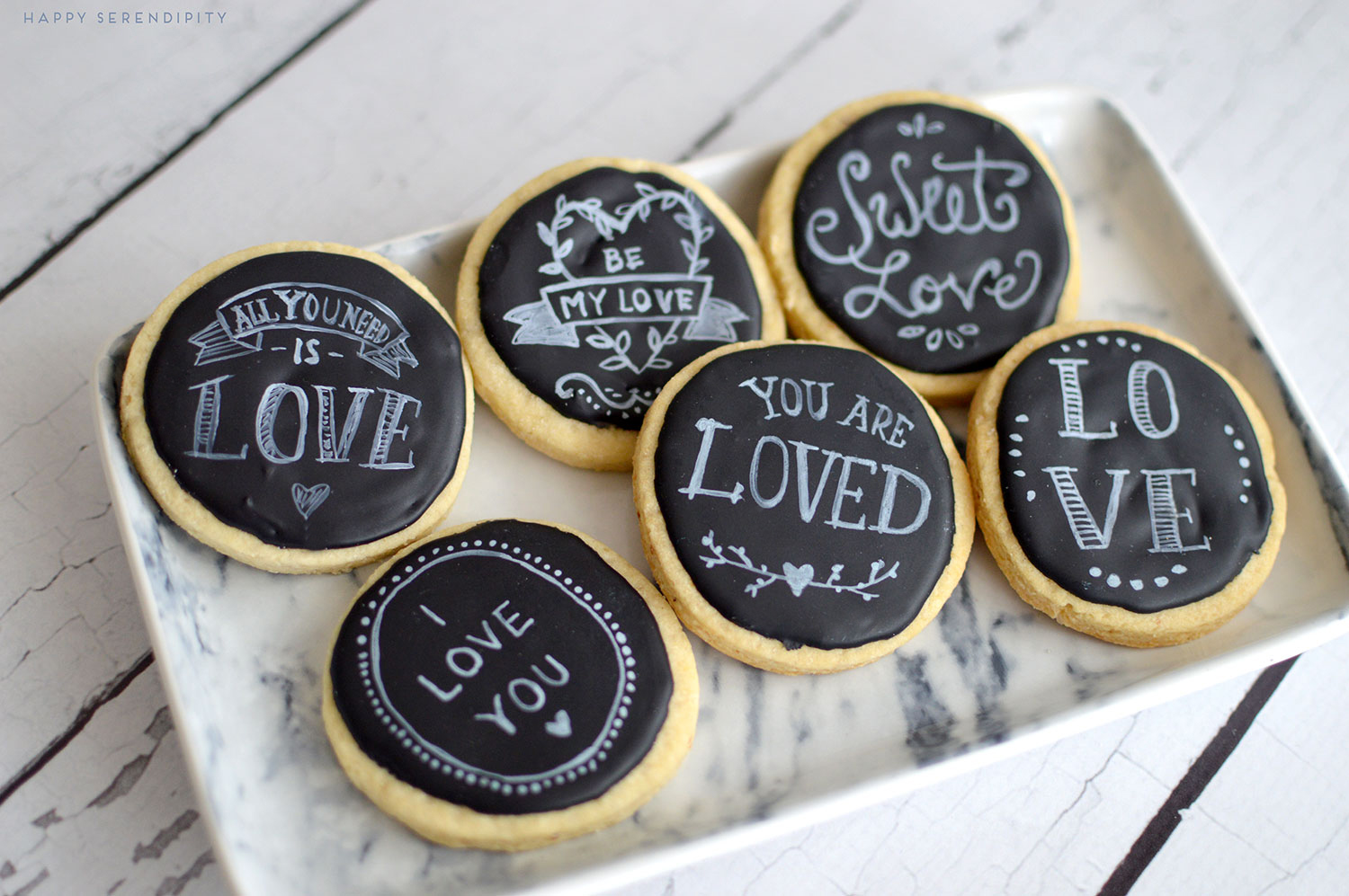 black royal icing and white sugarflair powder make beautiful chalkboard cookies | www.happyserendipity.com